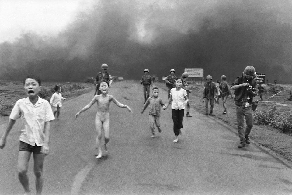 <p>1972. AP Caption: South Vietnamese forces follow after terrified children, including 9-year-old Kim Phuc, center, as they run down Route 1 near Trang Bang after an aerial napalm attack on suspected Viet Cong hiding places, June 8, 1972. A South Vietnamese plane accidentally dropped its flaming napalm on South Vietnamese troops and civilians. The terrified girl had ripped off her burning clothes while fleeing. The children from left to right are: Phan Thanh Tam, younger brother of Kim Phuc, who lost an eye, Phan Thanh Phouc, youngest brother of Kim Phuc, Kim Phuc, and Kim's cousins Ho Van Bon, and Ho Thi Ting. Behind them are soldiers of the Vietnam Army 25th Division. </p>