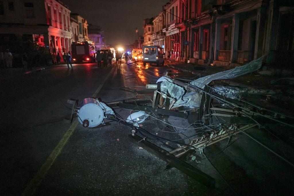 <p>A fallen utility pole is seen among debris in the tornado-hit Luyano neighbourhood in Havana early on Jan. 28, 2019. A tornado hit several neighborhoods in Havana overnight on Jan. 28, disrupting electrical power and damaging buildings and cars.Cuba's President Miguel Díaz-Canel says at least three people are dead and 174 have been injured. (Photo from Adalberto Roque/AFP/Getty Images) </p>