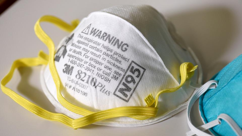 White N95 respiration mask with yellow elastic band