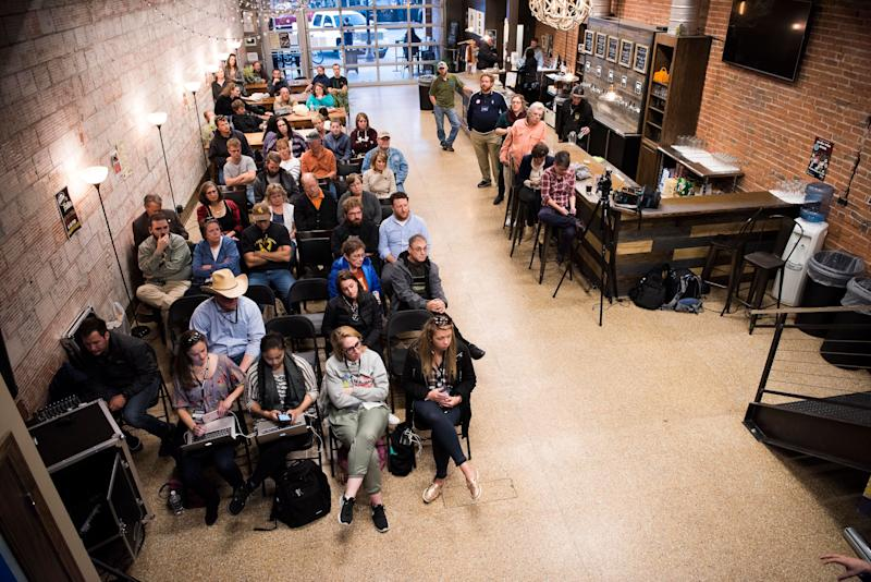 """Audience membersat""""When the Money Runs Out: Funding Schools in a Post-Bust Economy"""" at Frontier Brewing and Taproom."""