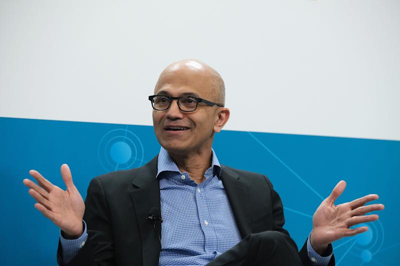 "BERLIN, GERMANY - FEBRUARY 27: Satya Nadella, CEO of Microsoft, speaks with Herbert Diess, CEO of Volkswagen AG, (not pictured) at a ""fireside chat"" to the media about a joint project between the two companies called the Volkswagen Automotive Cloud on February 27, 2019 in Berlin, Germany. Microsoft is working with several automakers to advance the carmakers' digitalization. (Photo by Sean Gallup/Getty Images)"