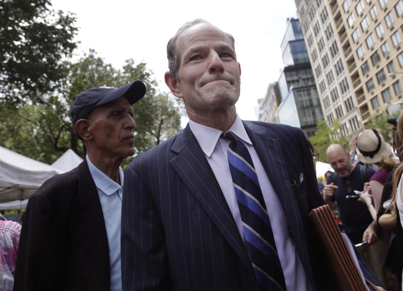 Former New York Gov. Eliot Spitzer walks through Union Square while he tries to collect signatures for his run for New York City comptroller in New York, Monday, July 8, 2013. Spitzer, who stepped down in 2008 amid a prostitution scandal, says he is planning a political comeback with a run for New York City comptroller.(AP Photo/Seth Wenig)