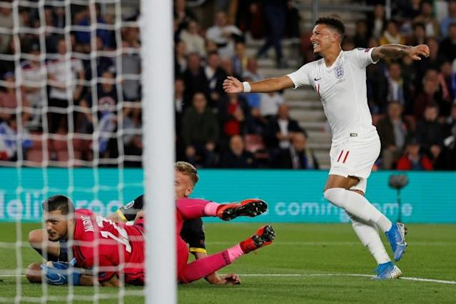 Teenage dreams: Jadon Sancho, 19, scored his first two England goals against Kosovo (AFP Photo/Adrian DENNIS)