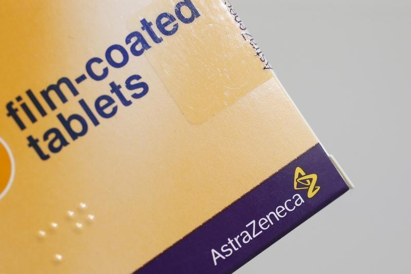 The logo of AstraZeneca is seen on a medication package in a pharmacy in London