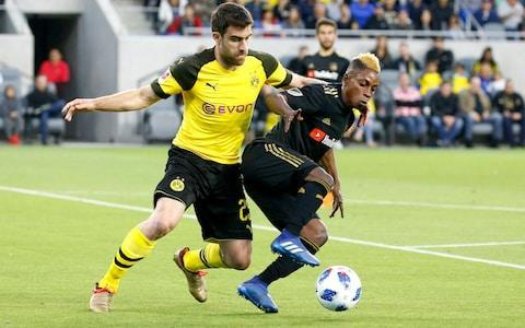 Arsenal have reached an agreement on a £16 million deal to make Sokratis Papastathopoulos their second summer signing under new manager Unai Emery, but his arrival from Borussia Dortmund will not be officially announced until next month. After already bringing in Stephan Lichsteiner from Juventus earlier this week on a free transfer, Sokratis is the second experienced defender that Emery will add to a squad that has lost Per Mertesacker and which will be without Laurent Koscielny at the start of next season. Sokratis, who is 29 and had one year left on his contract in Germany, has made 79 appearances for Greece and had played for Dortmund since joining from Werder Bremen in 2013. He previously played in Italy with Genoa and AC Milan and is likely to go straight into Emery's starting team. After Pierre-Emerick Aubameyang and Henrikh Mkhitaryan, he will also be the third player who worked previously with Arsenal's new head of recruitment, Sven Mislintat, at Dortmund. Aged 34, Lichsteiner will also add experience to Arsenal's back line and, with Champions League qualification the big target next season, the signings do seem to represent a continuation of the January transfer policy which committed considerable wages to proven players who will have only limited sell-on value. Sokratis is expected to agree a three-year deal. Sokratis Papastathopoulos (left) challenges Latif Blessing Credit: ap Arsenal do still want to blend the squad with emerging young talents and, while discussions are still at an early stage, they are interested in 17-year-old Paris St Germain midfielder Yacine Adli. He has been capped in various international age groups by France and was given his senior debut at PSG by Emery, where he has not signed a professional contract. Midfield is another transfer priority for Arsenal but the strategy in this area will be largely framed by contract talks with Aaron Ramsey. Emery is hoping to commit a significant part of what is a limited budget this summer to m