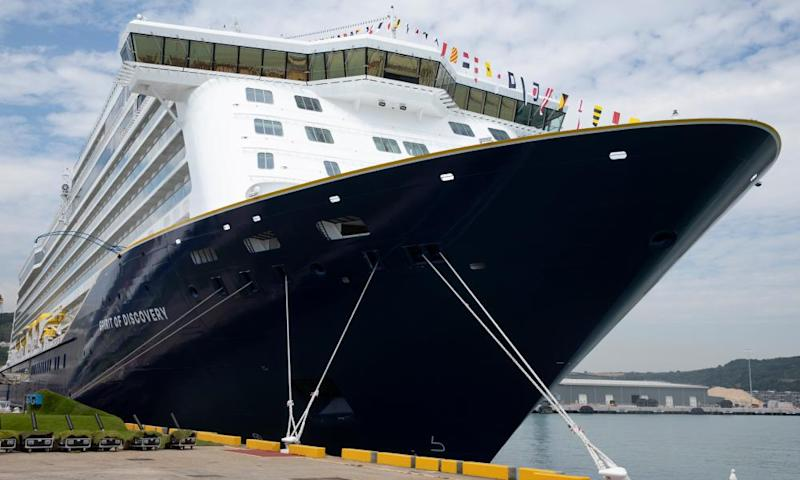 A picture of the front of a large Saga cruise liner with a dark blue hull tied up at a quay.