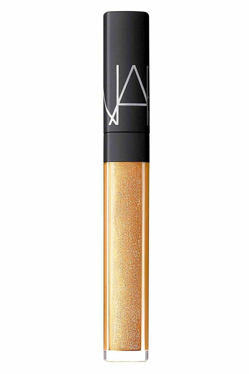 """<p><strong>NARS</strong></p><p>bloomingdales.com</p><p><strong>$26.00</strong></p><p><a href=""""https://go.redirectingat.com?id=74968X1596630&url=https%3A%2F%2Fwww.bloomingdales.com%2Fshop%2Fproduct%2Fnars-multi-use-gloss%3FID%3D3259745&sref=https%3A%2F%2Fwww.cosmopolitan.com%2Fstyle-beauty%2Fbeauty%2Fg12447782%2Fbest-lip-gloss%2F"""" rel=""""nofollow noopener"""" target=""""_blank"""" data-ylk=""""slk:Shop Now"""" class=""""link rapid-noclick-resp"""">Shop Now</a></p><p>I've been suuuper into the allover glossy look lately, thanks to this pick from Nars. At first glance, it looks like any other lip gloss, but it's so much more than just that. The creamy formula (which is filled with hydrating coconut oil and <a href=""""https://www.cosmopolitan.com/style-beauty/beauty/a27609307/vitamin-e-for-skin-benefits-products/"""" rel=""""nofollow noopener"""" target=""""_blank"""" data-ylk=""""slk:vitamin E"""" class=""""link rapid-noclick-resp"""">vitamin E</a>) <strong>can also be used on your cheeks and eyes</strong>, giving you a shimmery, glossy, and, more importantly, non-sticky finish.<br></p>"""