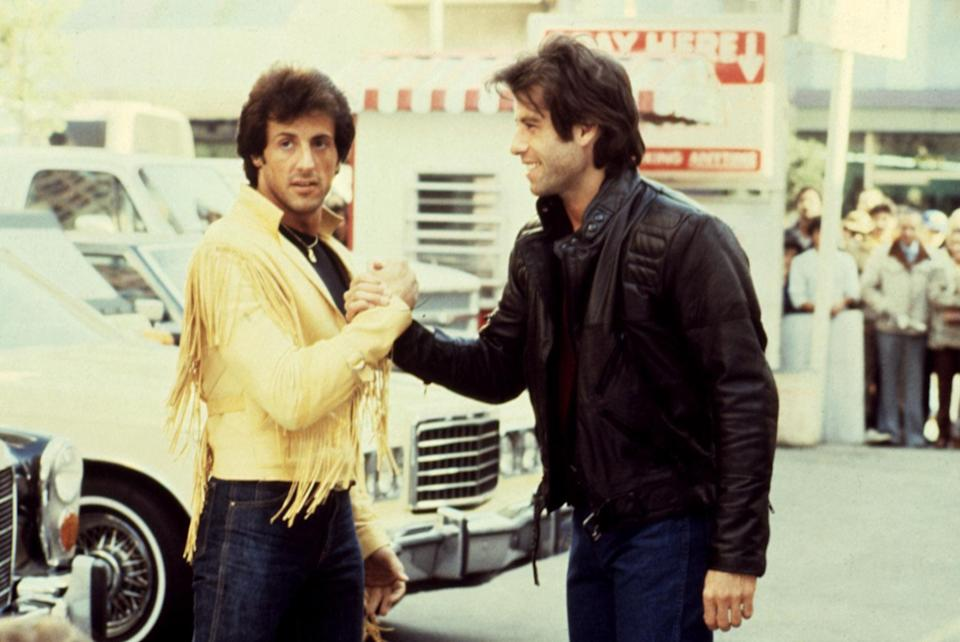 Stallone and John Travolta on the set of <em>Staying Alive</em>. At one point, Travolta was supposed to play Rambo's sidekick in <em>First Blood Part II</em>. (Photo: Paramount/courtesy Everett Collection)