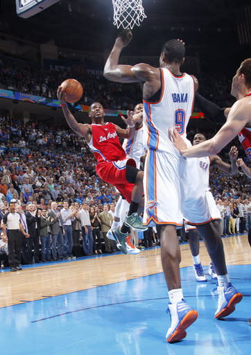 OKLAHOMA CITY, OK - APRIL 11: Chris Paul #3 of the Los Angeles Clippers takes the game winning shot to defeat the Oklahoma City Thunder on April 11, 2012 at the Chesapeake Energy Arena in Oklahoma City, Oklahoma. (Photo by Layne Murdoch/NBAE via Getty Images)
