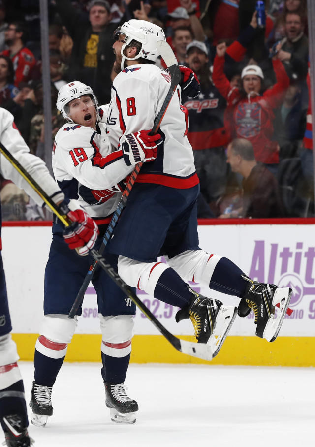 Washington Capitals left wing Alex Ovechkin, right, jumps into the arms of center Nicklas Backstrom, who scored in overtime of an NHL hockey game against the Colorado Avalanche on Friday, Nov. 16, 2018, in Denver. The Capitals won 3-2. (AP Photo/David Zalubowski)