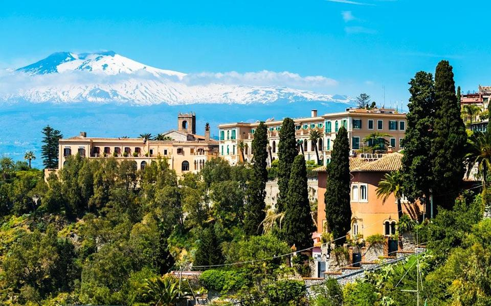 Explore Sicily's Etna region with its volcanic landscapes, fertile wine country and picture-perfect Taormina
