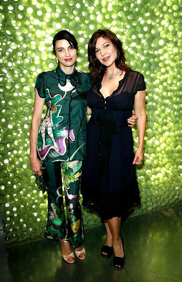 """Actresses Shiva Rose and Laura Harring (""""Mulholland Drive"""") strike a pose. Although Shiva is wearing Prada, we find the dress to be a little dowdy. Donato Sardella/<a href=""""http://www.wireimage.com"""" target=""""new"""">WireImage.com</a> - March 19, 2008"""
