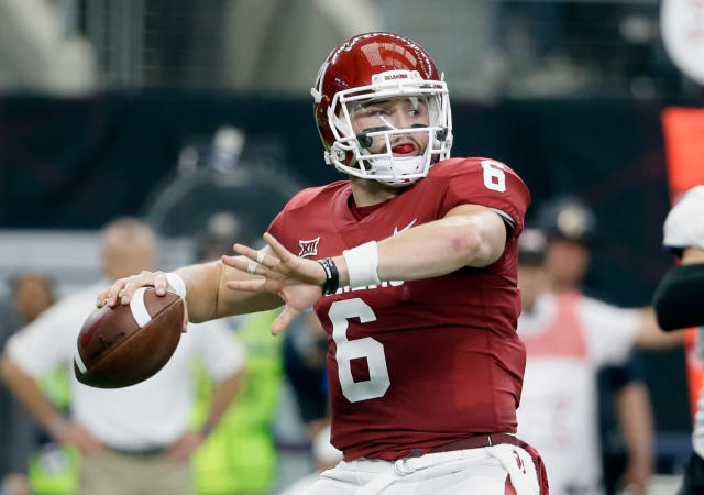 FILE - In this Dec. 2, 2017, file photo, Oklahoma quarterback Baker Mayfield (6) throws a pass in the first half of the Big 12 Conference championship NCAA college football game against TCU in Arlington, Texas. Every quarterback prospect in the upcoming NFL draft has a major flaw or drawback that keeps them from being the consensus best one of the bunch. (AP Photo/Tony Gutierrez, File)