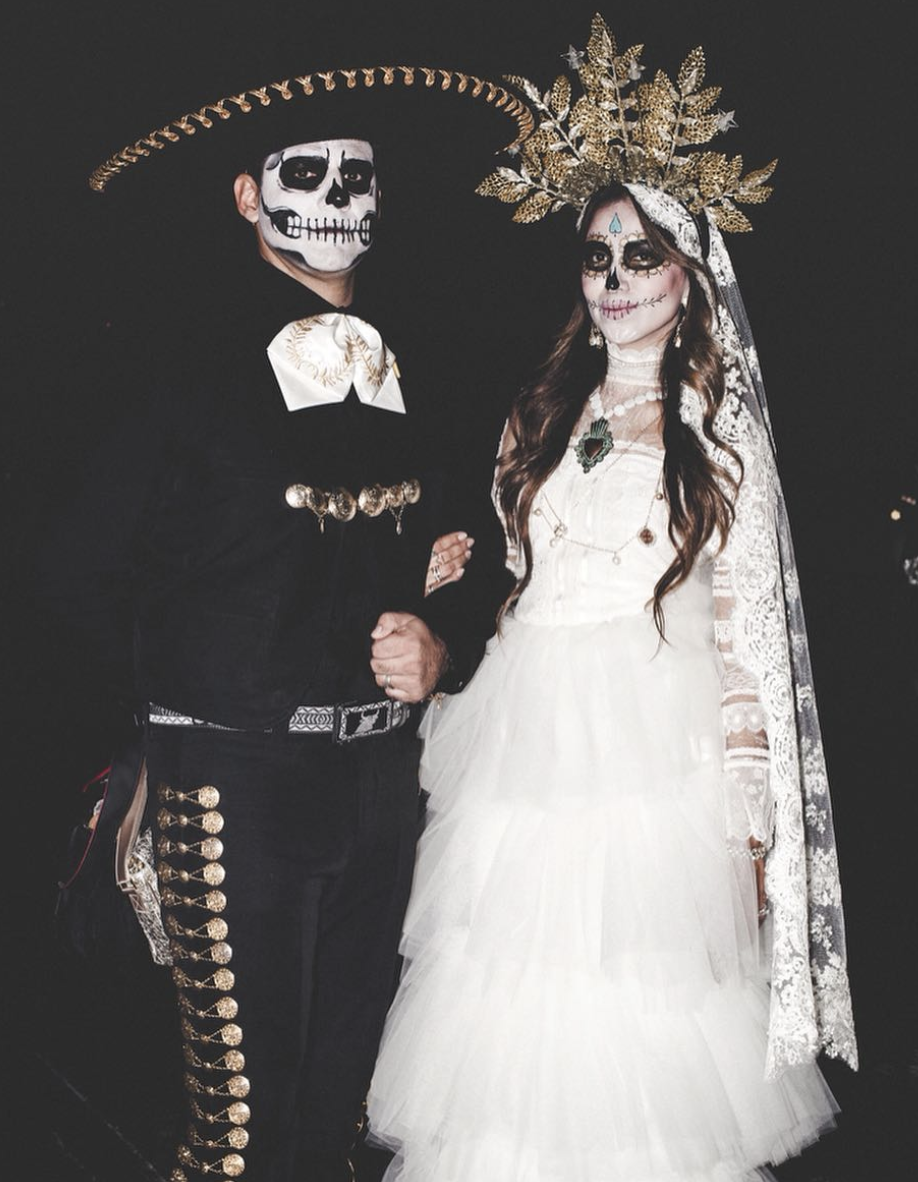 """<p>October 31st is not only Halloween, but it's also Day of the Dead. Celebrate the two traditions and wear your ensemble for both.</p><p><a class=""""link rapid-noclick-resp"""" href=""""https://www.amazon.com/Rehot-Masquerade-Mexican-Eyemask-Halloween/dp/B07HRZ3BYR/?tag=syn-yahoo-20&ascsubtag=%5Bartid%7C10072.g.27868801%5Bsrc%7Cyahoo-us"""" rel=""""nofollow noopener"""" target=""""_blank"""" data-ylk=""""slk:SHOP MASK"""">SHOP MASK</a></p>"""
