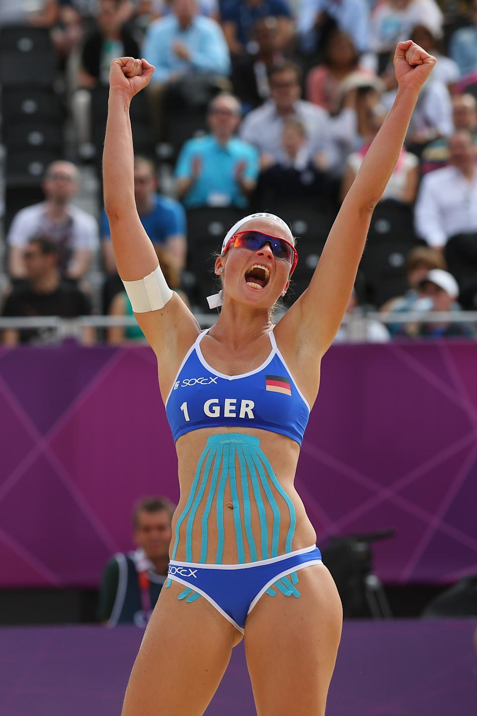 LONDON, ENGLAND - JULY 28: Katrin Holtwick of Germany celebrates during the Women's Beach Volleyball match between Germany and Czech Republic on Day 1 of the London 2012 Olympic Games at Horse Guards Parade on July 28, 2012 in London, England. (Photo by Alexander Hassenstein/Getty Images)