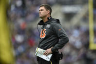 FILE - In this Sunday, Oct. 13, 2019, file photo, Cincinnati Bengals head coach Zac Taylor looks on during the first half of an NFL football game against the Baltimore Ravens, in Baltimore. Being a rookie head coach in the NFL is challenging enough, and also calling plays for the offense only increases the difficulty. Taylor is finding himself criticized and second-guessed for trying to do too much halfway through his first season. (AP Photo/Gail Burton, File)
