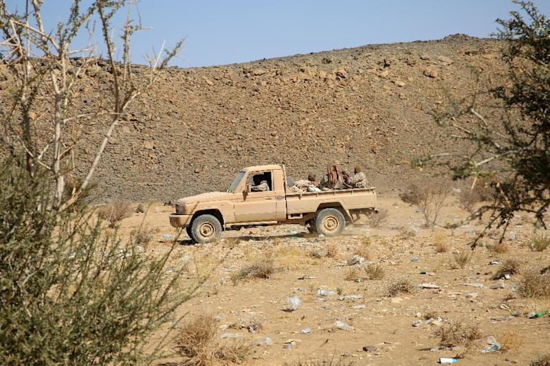 Armed Yemeni tribesmen from the Popular Resistance Committees, supporting forces loyal to Yemen's Saudi-backed President Abedrabbo Mansour Hadi, drive their vehicle as they hold a position in the area of Sirwah, west of Marib city, December 16, 2015