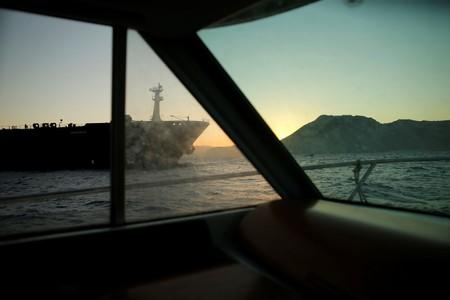 Iranian oil tanker Adrian Darya 1, previously named Grace 1, is pictured from windows as it sits anchored after the Supreme Court of the British territory lifted its detention order, in the Strait of Gibraltar