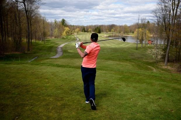 A golfer tees off at the Loch March Golf & Country Club in Ottawa on Saturday, May 16, 2020, during the COVID-19 pandemic. Ontario golfers are calling on the premier to backtrack on golf course closures. (Justin Tang/Canadian Press - image credit)