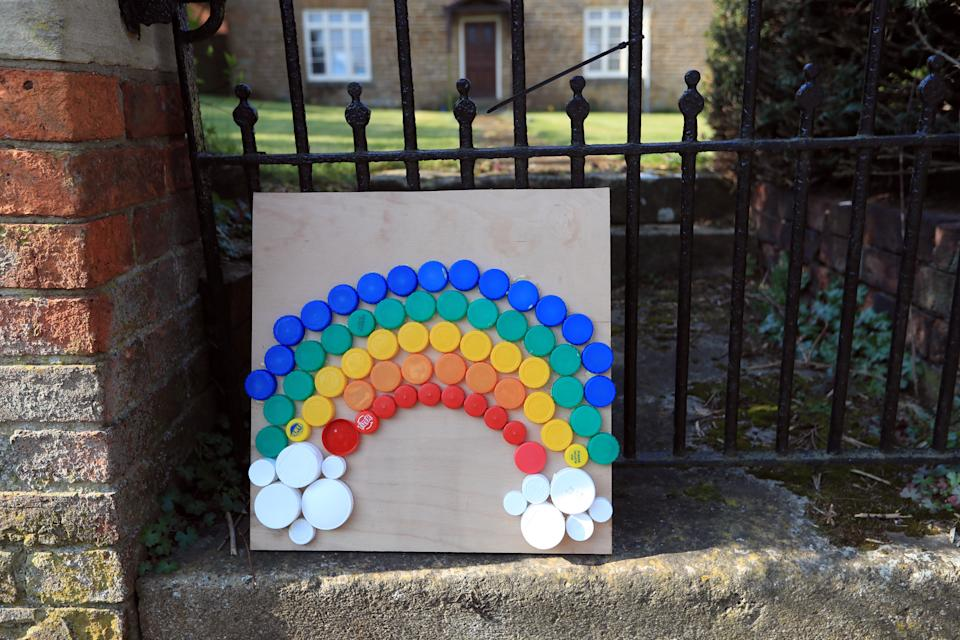 File photo dated 27/03/20 of a rainbow made from bottle caps in Muston, Leicestershire, as the UK continues in lockdown to help curb the spread of the coronavirus. Queen Elizabeth II gave a televised message to the nation during the coronavirus outbreak.