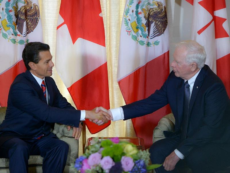 Mexican President Enrique Pena Nieto (L) shakes hands with the Governor General of Canada David Johnston at the La Citadelle official residence in Quebec, on June 27, 2016