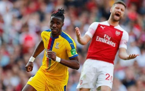 <span>Zaha waltzed past Shkodran Mustafi on Sunday to score his eighth away goal of the season, putting him third in the standings behind Harry Kane and Jamie Vardy</span> <span>Credit: Reuters </span>