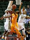 Tennessee guard Kevin Punter (0) shoots as Marquette forward Juan Anderson (10) and guard JaJuan Johnson (23) try to block the shot during the first half of an NCAA college basketball game in Lake Buena Vista, Fla., Sunday, Nov. 30, 2014. (AP Photo/Reinhold Matay)