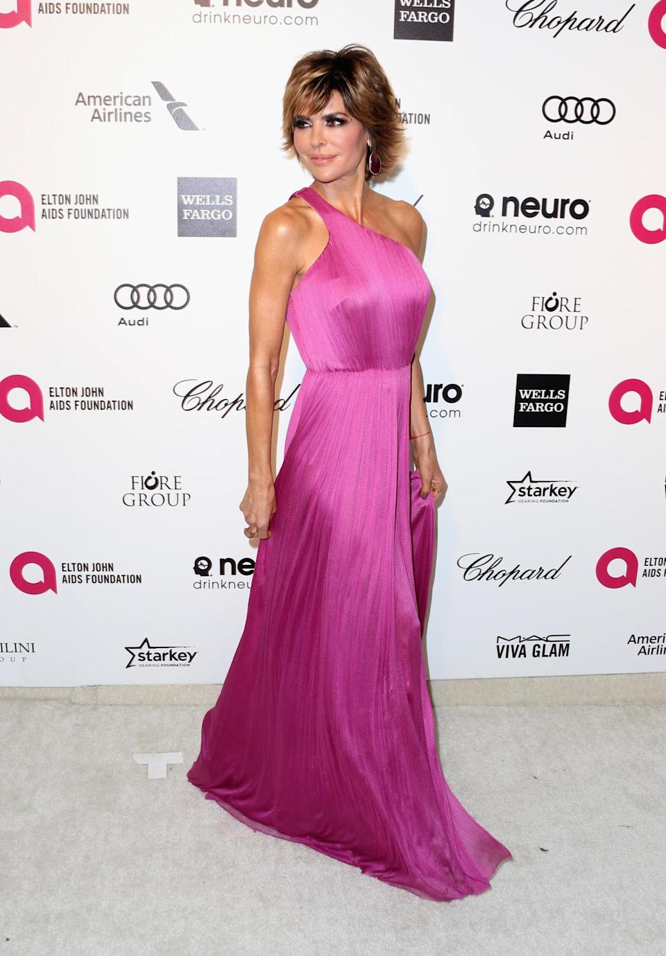 The Real Housewife wore a pink gown one-shoulder silk gown that looks like a style favorite amongst the prom set but she pulls it off with aplomb at 51.