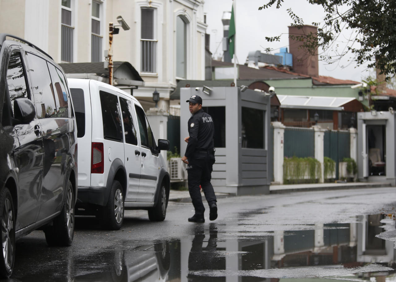 A Turkish police officer walks outside the Saudi Arabia consul general residence in Istanbul, Thursday, Oct. 18, 2018. Turkish crime-scene investigators finished an overnight search of both residence and a second search of the consulate itself amid Ankara's fears that Saudi writer Jamal Khashoggi was killed and dismembered inside the diplomatic mission in Istanbul. (AP Photo/Lefteris Pitarakis)