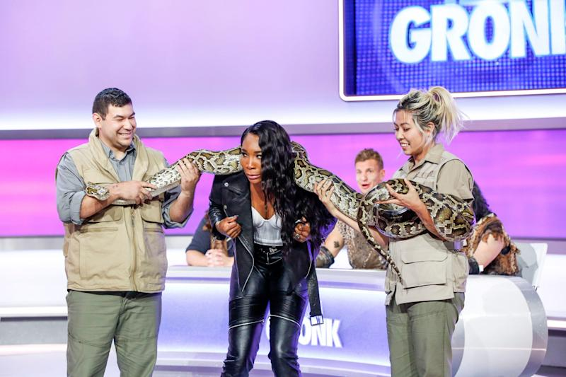 Tennis champ and 'Game On!' captain Venus Williams, center, must get up close with a snake as the price for a team loss on an episode of the CBS reality game show.