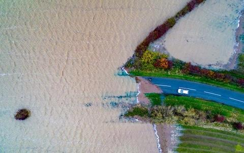 More than 1,000 acres of farmland in Lincolnshire have been submerged  - Credit: Geoff Robinson
