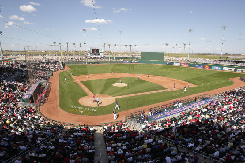 FILE - In this Saturday, March 6, 2010 file photo, The Cincinnati Reds play the Cleveland Indians in a spring training baseball game at Goodyear Ball Park in Goodyear, Ariz. Putting all 30 teams in the Phoenix area this season and playing in empty ballparks was among the ideas discussed Monday, April 6, 2020 during a call among five top officials from MLB and the players' association that was led by Commissioner Rob Manfred, people familiar with the discussion told The Associated Press.  (AP Photo/Mark Duncan, File)