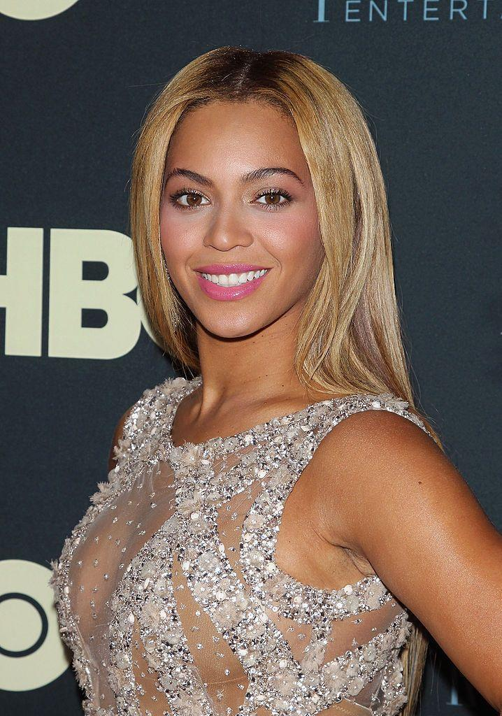 <p>If you're not a fan of matte lipstick, no worries. Beyonce's pink glossy lip is here to save the day. Add some light pink blush to your cheeks as well to finish out this look. </p>