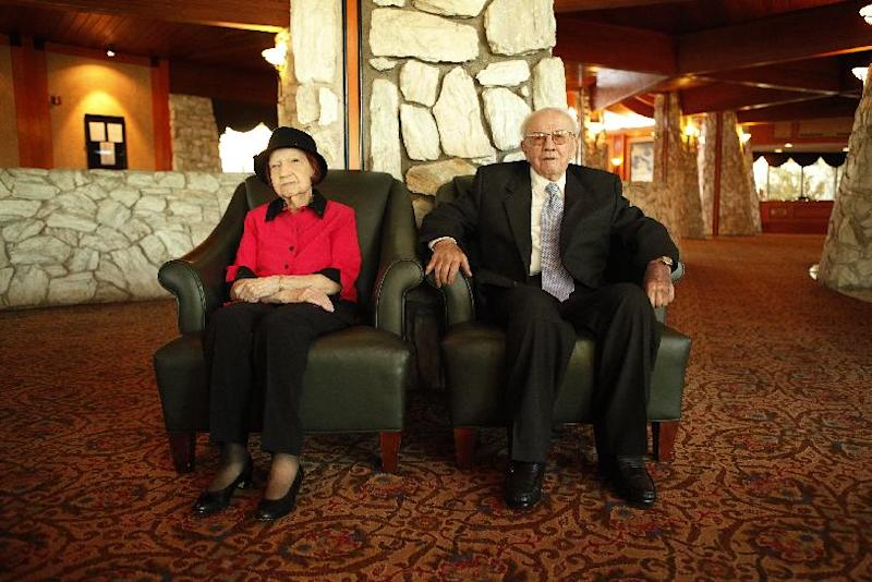 In this Jan. 24, 2012 photo, Theresa Faiss, 96, and her husband, Wilbur, 100, pose for a photo at the Las Vegas Country Club in Las Vegas. Theresa Faiss died Sunday, Oct. 28, 2012 in Las Vegas at the age of 97, just months after the couple was recognized as being the longest married couple in America,  (AP Photo/Las Vegas Review-Journal, John Locher) LOCAL TV OUT; LOCAL INTERNET OUT; LAS VEGAS SUN OUT