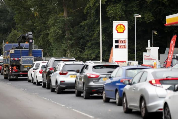 Vehicles queue to refill outside a Shell fuel station in Redbourn