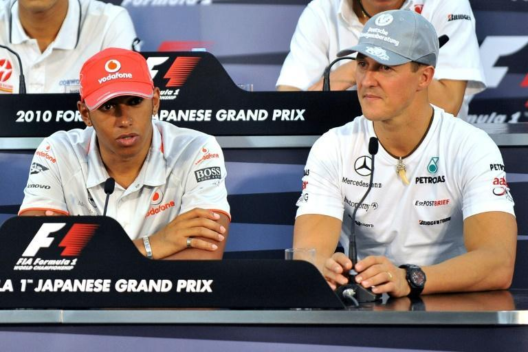 Michael Schumacher pictured in 2010 with Lewis Hamilton, the driver who this year equalled his record of seven world titles