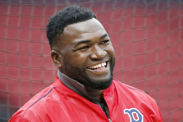 FILE - In this April 12, 2016, file photo, Boston Red Sox's David Ortiz smiles during batting practice before a baseball game against the Baltimore Orioles, in Boston. Former Boston Red Sox slugger David Ortiz was hospitalized Monday following surgery for a gunshot wound after being ambushed by a man in a bar in his native Dominican Republic, authorities said. Dominican National Police Director Ney Aldrin Bautista Almonte said Ortiz was at the Dial Bar and Lounge in Santo Domingo around 8:50 p.m. Sunday, June 9, 2019, when a gunman approached from behind and shot him at close range. Ortiz was taken to the Abel Gonzalez clinic, where he underwent surgery, and his condition was stable, Bautista said. (AP Photo/Michael Dwyer, File)