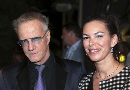 """Actor Christopher Lambert arrives with actress Sophie Desmarais for a  photocall October 16, 2016 for the television series """"Mata Hari"""" during the annual MIPCOM television programme market in Cannes, France.   Picture taken October 16, 2016.   REUTERS/Eric Gaillard"""