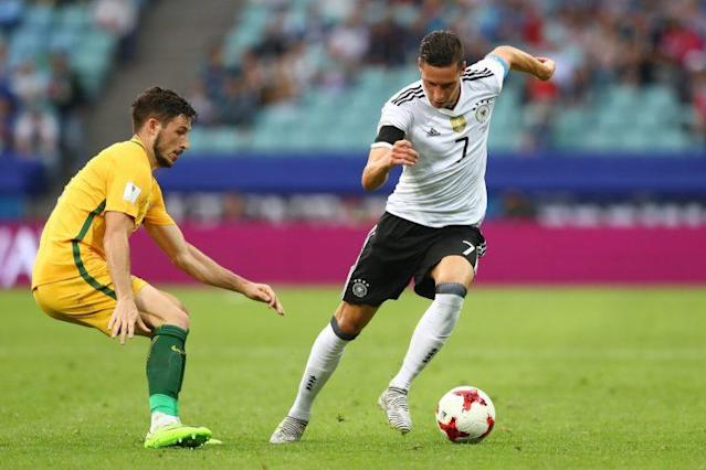 "Captain <a class=""link rapid-noclick-resp"" href=""/soccer/players/julian-draxler/"" data-ylk=""slk:Julian Draxler"">Julian Draxler</a>, just 23 years old, helped lead a young German side to a win over Australia. (Getty)"