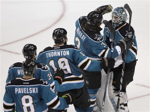 San Jose Sharks goalie Antti Niemi (31), of Finland, is congratulated by teammates after defeating the Phoenix Coyotes 4-3 in an overtime shootout during an NHL hockey game in San Jose, Calif., Saturday, March 24, 2012. (AP Photo/Paul Sakuma)