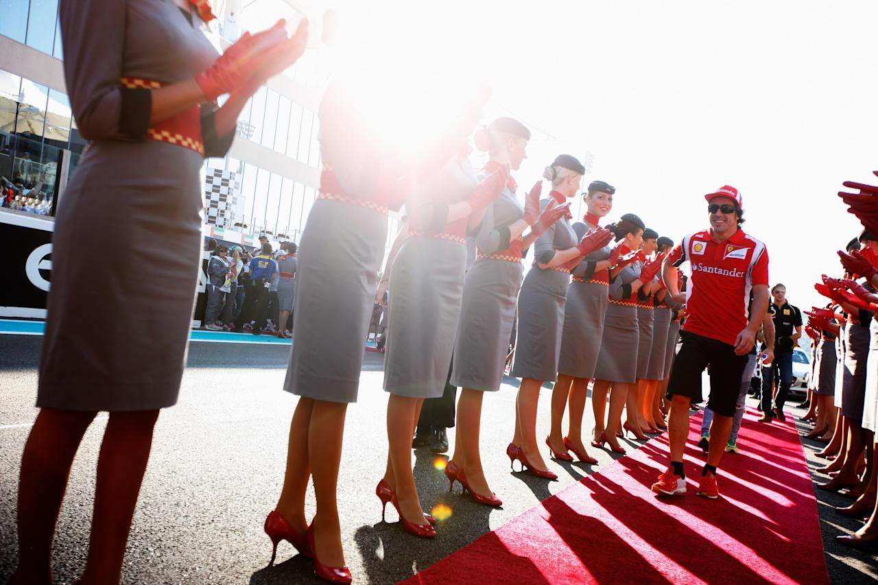 ABU DHABI, UNITED ARAB EMIRATES - NOVEMBER 13:  Fernando Alonso of Spain and Ferrari attends the drivers parade before the Abu Dhabi Formula One Grand Prix at the Yas Marina Circuit on November 13, 2011 in Abu Dhabi, United Arab Emirates.  (Photo by Mark Thompson/Getty Images)