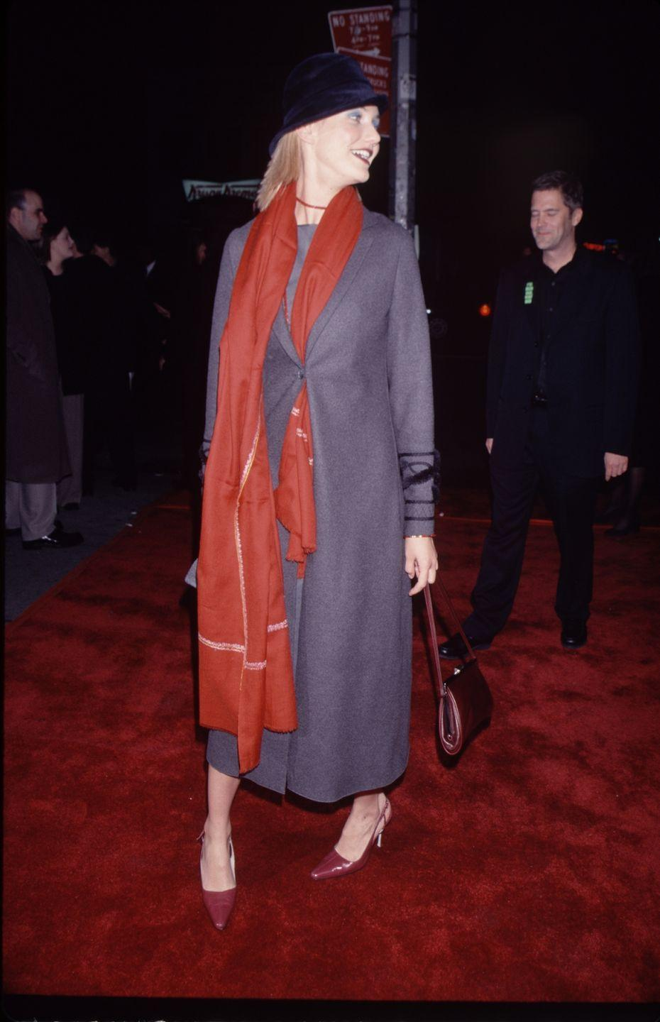 <p>Okay, I know Cameron has a scarf buttoned into her coat and a fedora, but can we talk about her blue eyeshadow for a sec? If that isn't the most '90s thing you've ever seen, IDK what is. </p>