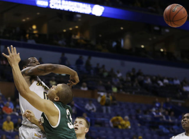 Wichita State forward Chadrack Lufile (0) blocks a shot by Cal Poly forward Chris Eversley (33) during the first half of a second-round game in the NCAA college basketball tournament Friday, March 21, 2014, in St. Louis. (AP Photo/Jeff Roberson)