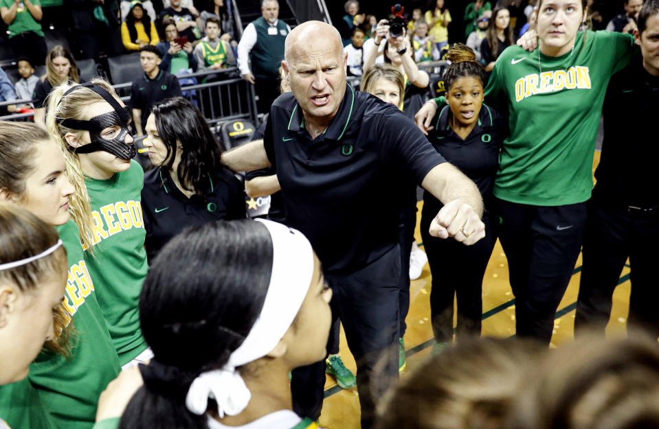 FILE - In this March 1, 2020, file photo, Oregon head coach Kelly Graves, center, talks to his team before playing Washington in an NCAA college basketball game in Eugene, Ore. (AP Photo/Thomas Boyd, File)