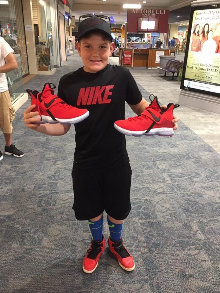 Jordan was completely thrilled to receive the brand-new red basketball boots. Source: Facebook/Tinyia Frank