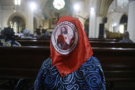 A parishioner takes part in a Stations of the Cross service during Good Friday at the Holy Cross Cathedral in Lagos, Nigeria, Friday, April 2, 2021. (AP Photo/Sunday Alamba)