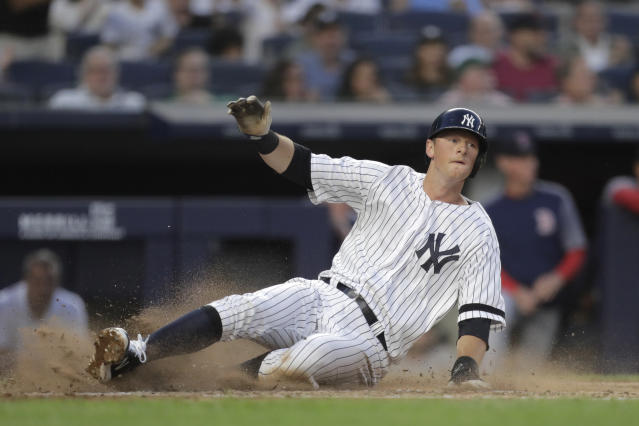 New York Yankees' DJ LeMahieu slides in safely while scoring on a two-run single by Aaron Hicks off Boston Red Sox starting pitcher Chris Sale during the third inning of a baseball game Friday, May 31, 2019, in New York. (AP Photo/Julio Cortez)