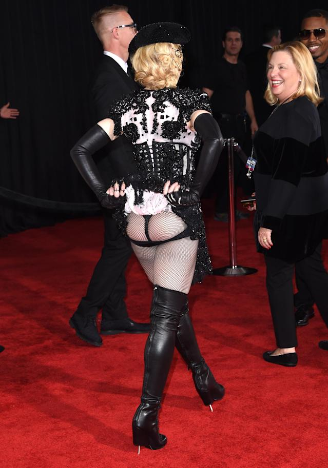 <p>Madonna's custom Givenchy haute couture look might have been fairly flash from the front, but it was the other side that had onlookers gasping. The singer left almost her entire bottom on display, with just – what looked like – an elasticised band supporting her cheeks. <em>[Photo: Getty]</em> </p>