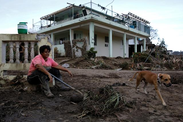 <p>Carmen Marrero takes a rest while she cleans debris from her house after the area was hit by Hurricane Maria in Toa Baja, Puerto Rico September 24, 2017. (Photo: Carlos Garcia Rawlins/Reuters) </p>