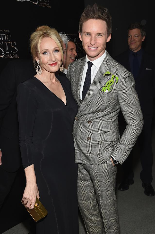 <p>The 'Harry Potter' author and 'Fantastic Beasts' writer with star Eddie Redmayne, who plays wizard Newt Scamander. (Photo: Jamie McCarthy/Getty Images) </p>